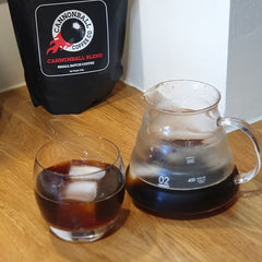 iced cannonball coffee in a hario jug with ice cubes