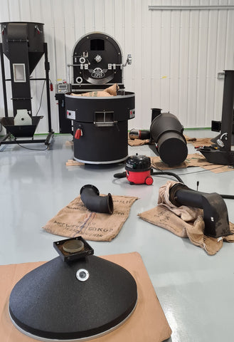 20kg joper coffee roaster with parts laid out around it