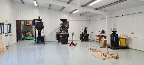 20kg and 3kg coffee roasting machines in a large white factory setting