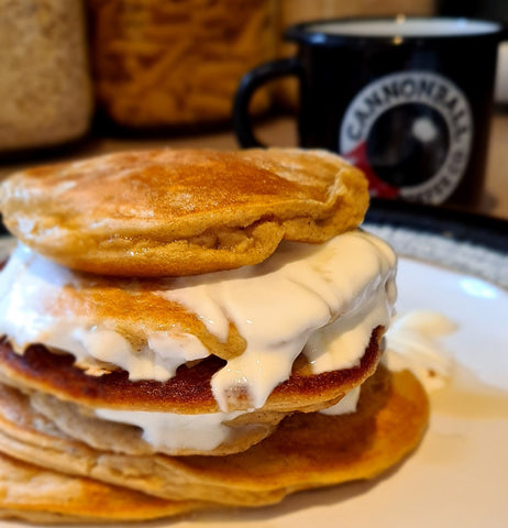 stack of protein pancakes and a cup of cannonball coffee