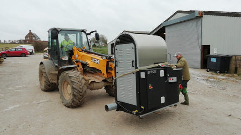 moving the coffee roaster on a jcb