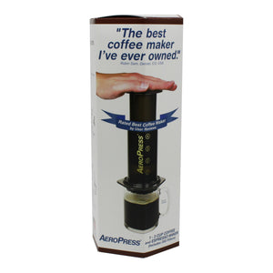 aeropress coffee maker in its box. features a picture of the a coffee being brewed using the press and the quote 'The best coffee maker I've ever owned' from a customer