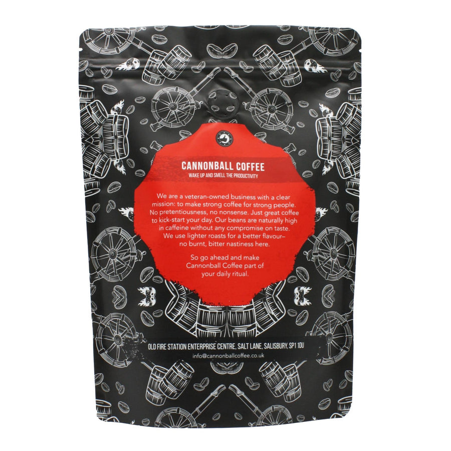 Image of the back of a packet of Cannonball Coffee. Features images of cannons, cannonballs, coffee beans and gunpowder barrels of a black background. In the middle the text reads: Wake Up and Smell the Productivity. We are a veteran owned company with a clear mission: to make strong coffee for strong people. No pretentiousness, no nonsense. Just great coffee to kick-start your day. Our beans are naturally high in caffeine without any compromise on taste.