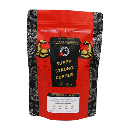 Front of a bag of Cannonball Coffee. The bag has a bright red background. In the centre is a black coffee cup with biceps bursting out of the sides. The cup says 'Super Strong Coffee' on it.