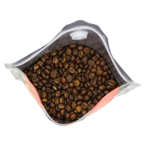 close-up of freshly roasted Cannonball Blend beans. It is a blend of medium roast brazilian arabica and rwandan robust beans, with a chocolate appearance.