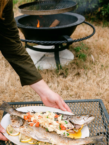 Grilled fish on the fire kettle