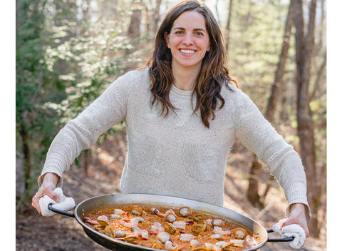 Chef Katie Button of Cúrate cooks Paella over open fire.