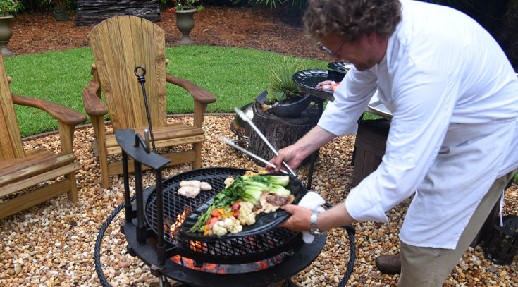 Chef Dave Snyder cooks over SIF Kettle