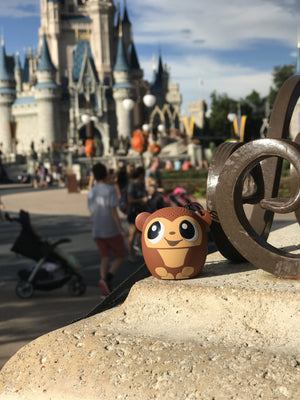 My Audio Pet GoGoBananas Wireless Bluetooth Speaker with True Wireless Stereo Monkey posing at the Disney Cinderella Castle in Disney's Magic Kingdom