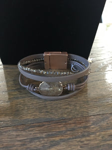 Taupe leather bracelet with stone.