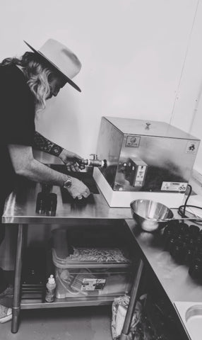 John creating beard balm in his studio in Kingston upon Thames.