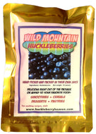 Fresh huckleberries packaged in their own juice. One ten ounce gold foil package.