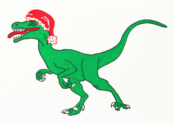 Green velociraptor wearing a Christmas hat card