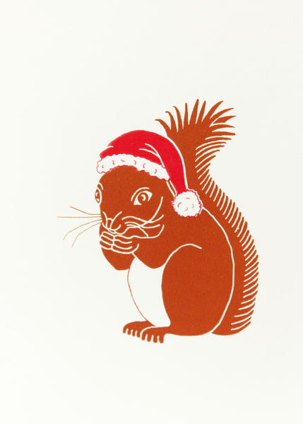 Squirrel wearing a red Christmas card