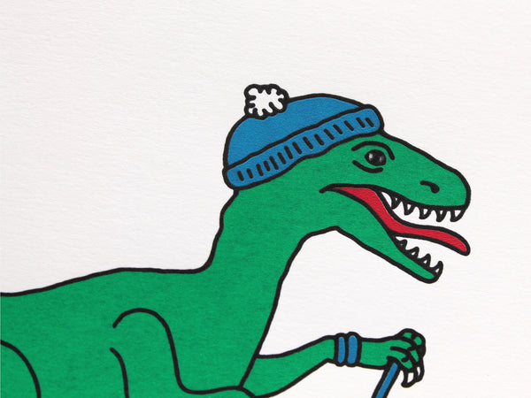 Green velociraptor on red skis with a blue bobble hat