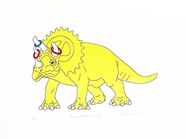 Yellow dinosaur with hoopla rings on its horns
