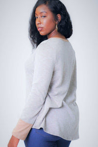 Solid, Waist Length Long Sleeve Top In A Relaxed Style With A Round Neck And Faux Suede Contrast Wrist Cuff. [chicberri]