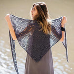 Woman wearing Bayou shawl in Quince Kestrel
