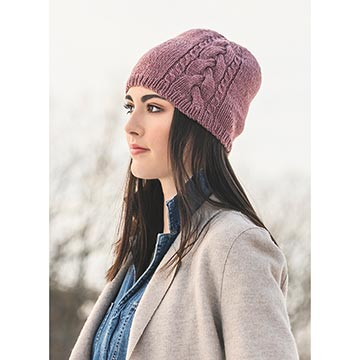 woman wearing claremont cabled hat knit in Blue Sky Fibers Woolstok yarn