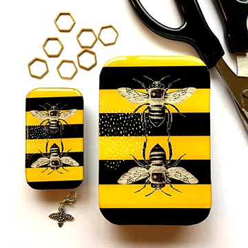 Bee notions tin with honeycomb stitch markers