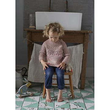Child wearing the Hygge Baby sweater from Loop London