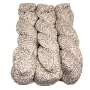 hanks of Illimani Sabri yarn in Marzipan