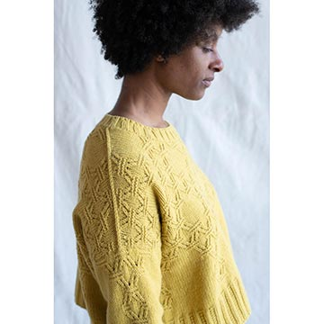 Woman wearing the Intricate Pullover from Norah Gaughan