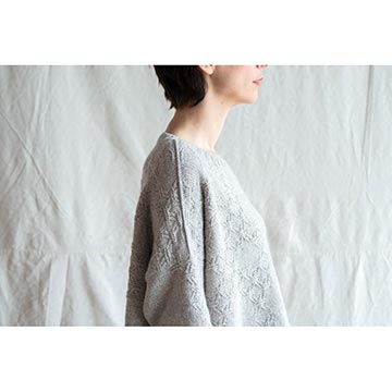 Woman wearing the Intricate Pullover cashmere sweater