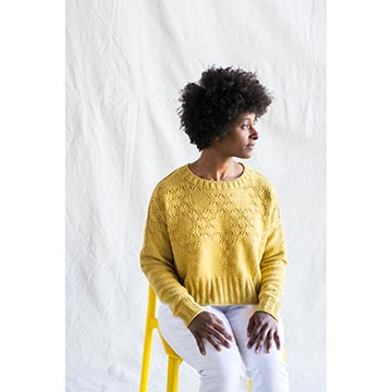 Woman wearing a yellow cashmere sweater