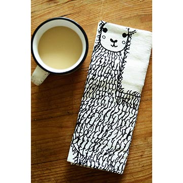 Llama tea towel with a cup of tea