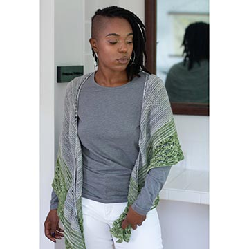Woman wearing the Romneya shawl in Manos Fino