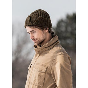 man wearing the split rib hat knit in baby alpaca yarn