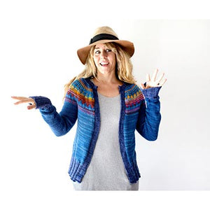 Woman in a hat wearing the Throwback cardigan by Andrea Mowry