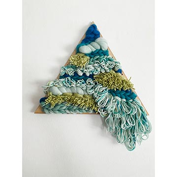 completed woven triangle loom in blue and yellow yarn