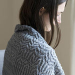 Woman wearing a shawl in Lisse pattern by Bristol Ivy