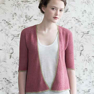 Woman wearing Petunia cardigan in Quince and Co Sparrow linen yarn