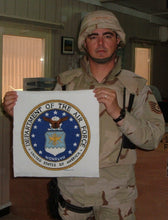Richard B with the finished emblem that he stitched (cross stitch pattern of the US Air Force Emblem adapted to cross stitch by Sherry from Military XStitch Com