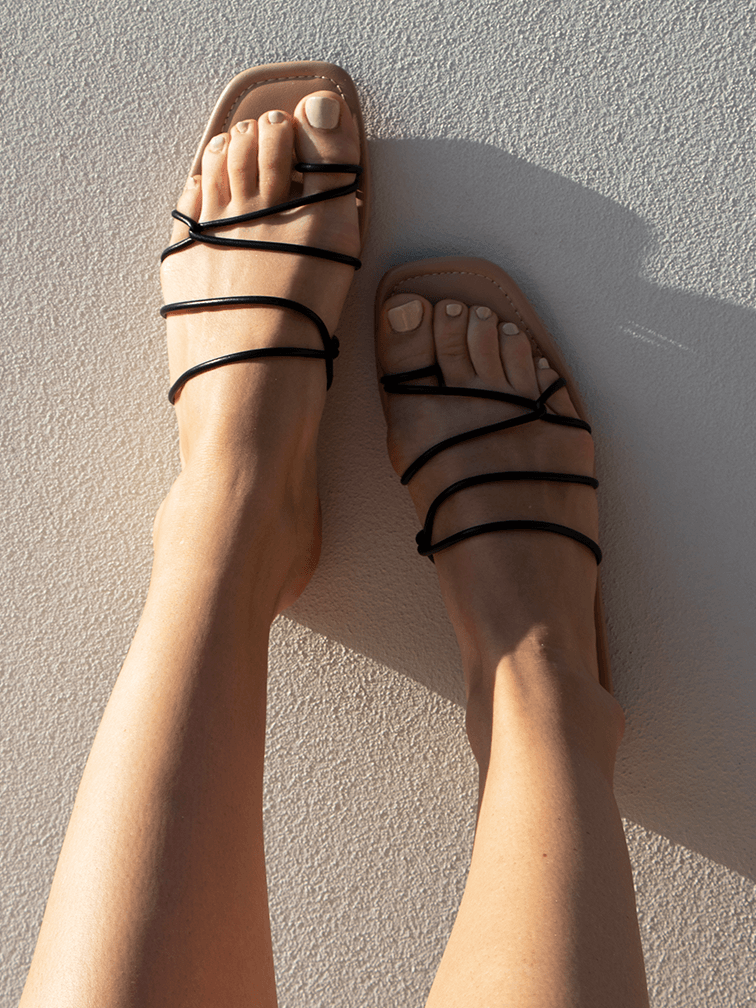 Covet Shoes Black Strappy Flat Sandals on foot