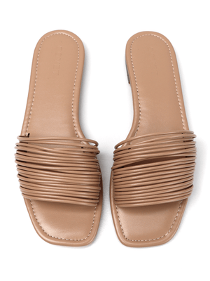 Birds eye view of flat nude slide sandals with multiple thin soft straps