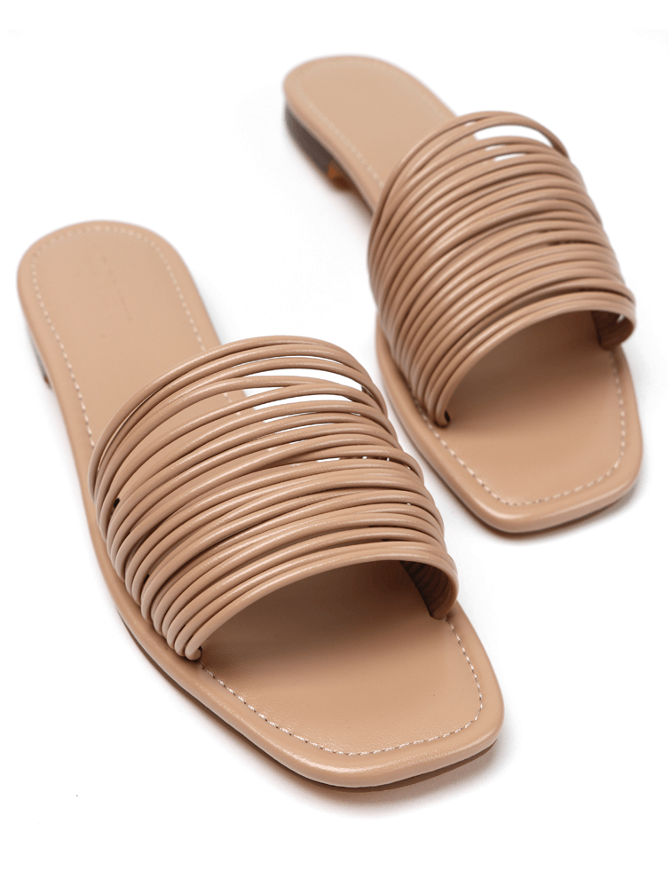 Pair of strappy nude flat sandals