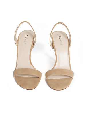 Front view of a pair of nude slingbacks stiletto heels