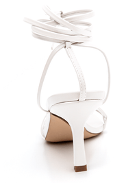 Heel view of Covet Shoes Off White Lace Up Stiletto Heels