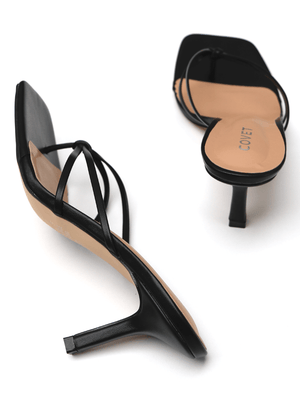 Birds eye view of pair of black stiletto heels from Covet Shoes. One on the side and one facing the back