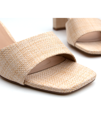Close up of woven block heels in a natural colour from Covet Shoes