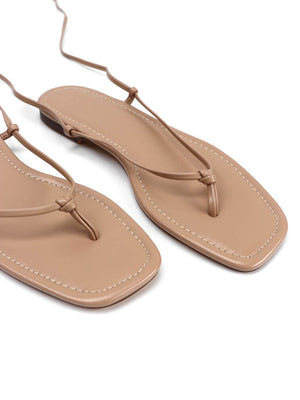 Close Up of  pair of nude flat sandals