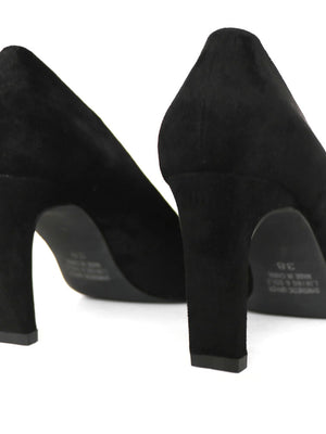 Detail of block heel on black pumps