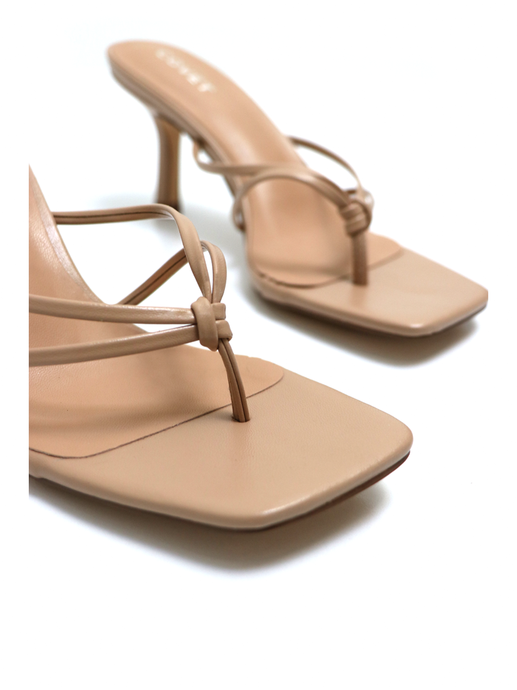 Close up of knot details for nude heeled thong sandals