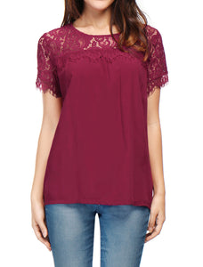 Sheer lace panels at the yokes and billowy, short sleeves enrich the romantic appeal of a flowy crepe blouse