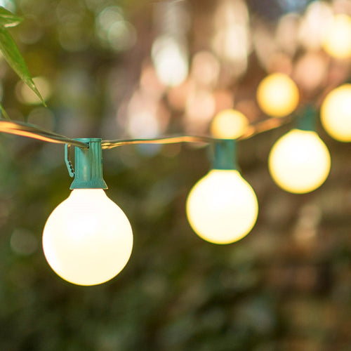 Globe String Lights, 2 Inch E12 Bulbs, 50 Foot Green Wire C7 Strand, Pearl White