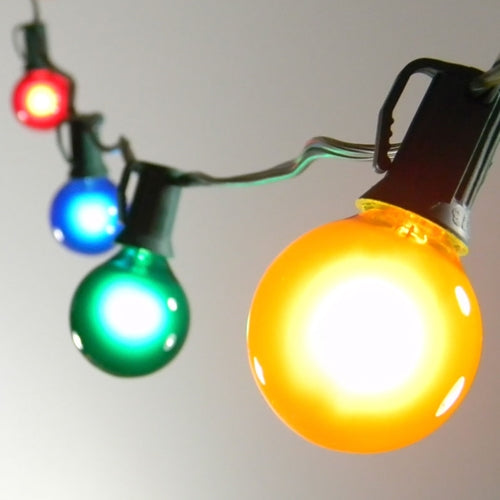 Twinkling Globe String Lights, 1.5 Inch E12 Bulbs, 24 Foot Green Wire C7 Strand, Multi Color